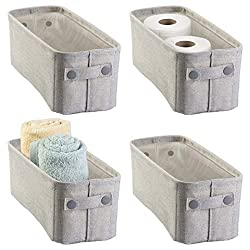 narrow gray storage baskets used to hold toilet paper rolls