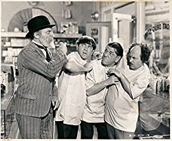 Elderly landlord Emil Sitka threatens to evict pharmacists Moe, Shemp, and Larry in All Gummed Up
