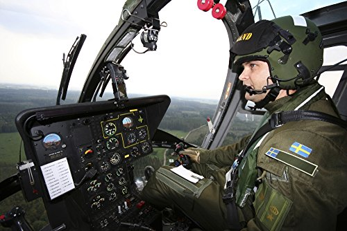 Daniel Karlsson/Stocktrek Images – Inside The MBB BO 105 Helicopter of The Swedish Air Force. Photo Print (44,20 x 29,46 cm)