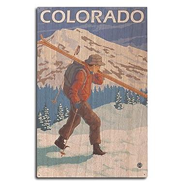 Colorado - Skier Carrying Skis (10x15 Wood Wall Sign, Wall Decor Ready to Hang)