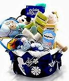 Tarta de pañales con productos para el cuidado del bebé, té, caja de música,...