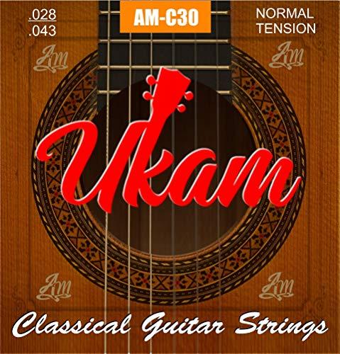 Cuerdas guitarra clasica,española UKAM mod.AM-C30 alta calidad y tres púas celuloide tipo concha diferentes grosores (0.46, 0.71, 0.96).