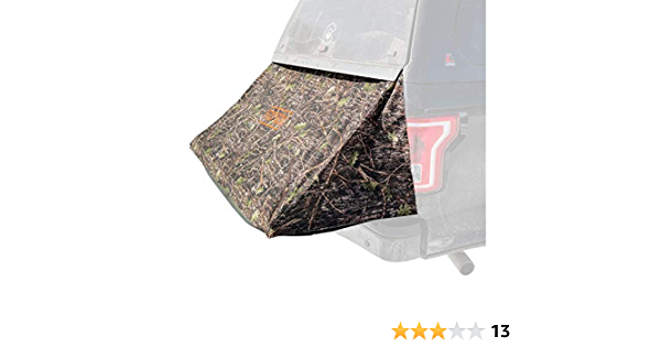 A Truck Tent for Camping That extends The Bed of a Truck with a Topper footbox