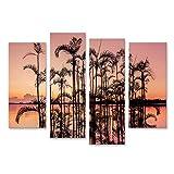 Bild auf Leinwand Palme im orangefarbenen Sonnenuntergang