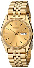 Gold-tone watch in stainless steel with coin-edge bezel featuring date window at 3 o'clock and slender hands mm gold-tone stainless steel case with Hardlex dial window Gold-tone stainless steel link bracelet with foldover clasp closure Water resistan...