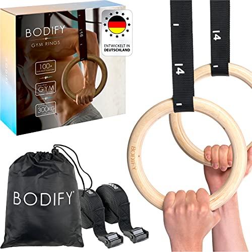 Bodify® Gymnastikringe – Turnringe aus Holz mit Trainingshandbuch und Türstopper – Gym Rings für Crossfit und Gymnastik - Übungen für Zuhause und Outdoor – Einstellbare Gurte mit Markierungen