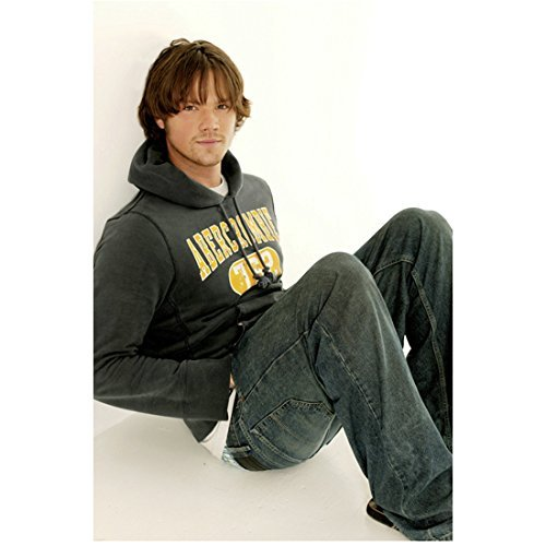 Supernatural Jared Padalecki as Sam Winchester Wearing Hoodie Smiling Seated on Ground 8 x 10 Photo