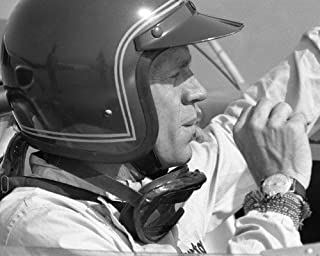 Steve McQueen in racing car cool look with classic watch 8x10 Promotional Photograph