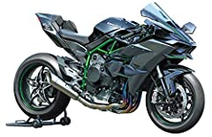 Detailed inline-4 engine and supercharger depictions. Engine, swing arm, front fork, plus upper, side and seat cowls are attached to frame by minute screws. Features synthetic rubber depictions of front/rear slick tires, plus a separate racing stand ...