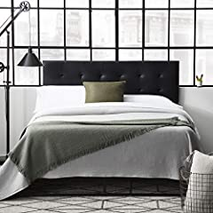 Mid-riseheadboard has seven different adjustable height options between 34 and 46 inches Asophisticated faux leather finish draws the eye without being overbearing to create a gorgeous statement piece for any bedroom Buttonless diamond tufting and ...