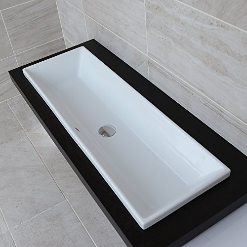 Under-counter or self-rimming porcelain lavatory with an overflow. W: 41 3/8', D: 13 3/8', H: 6 3/4'.