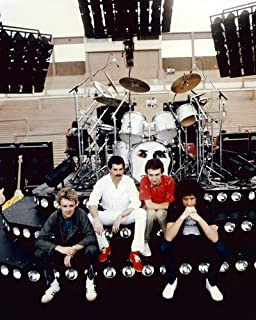 Queen the band sitting on stage in front of drum kit 1970's 8x10 Promotional Photogra