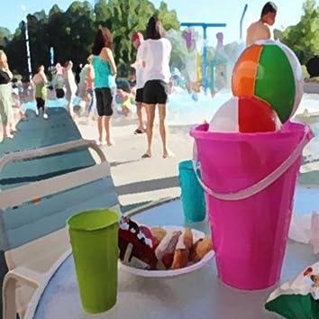 Children Splashing and Playing at the Pool