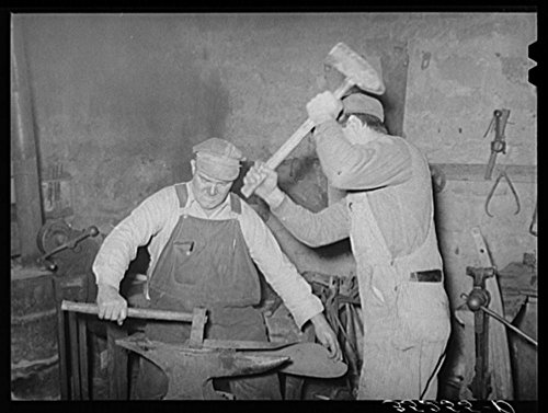 New 1940 Photo Blacksmith and helper pounding out plow point. Depew, Oklahoma Location: Creek County...
