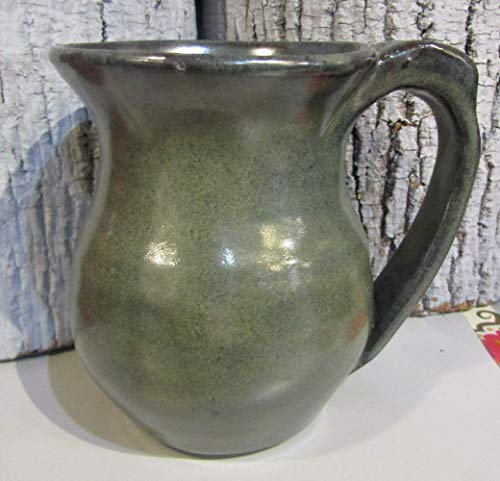 Green pottery mug with thumb rest