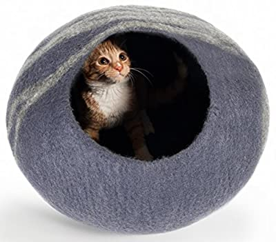 the twin critters ecofriendly cat bed or cave, basically a sphere with a hole in it made of wool