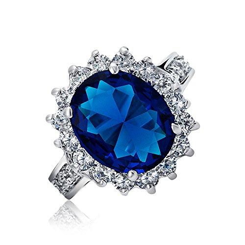 Bling Jewelry 5Ct Royal Azul Oval Simulado Zirconio Cúbico CZ Corona Engrane Halo Anillo Mujer Pave Banda De Latón Chapados En Plata.