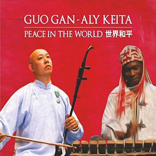 Guo Gan,  Aly Keita