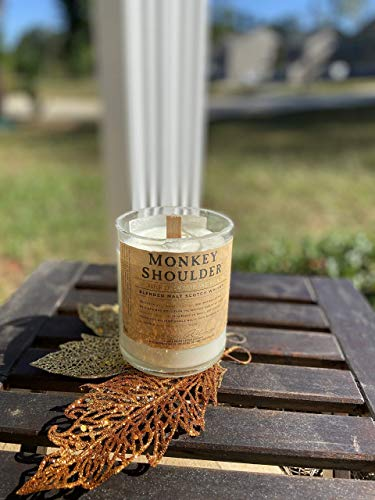 Hand poured wax candle with wooden wick in repurposed glass