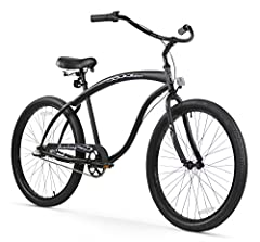 "26"" cruiser bike for men Matte black frame beach cruiser with black tires and rims Shimano Nexus Internal 3-speed hub Beefy looking cruiser bike made by Firmstrong Coaster brakes and plush saddle"