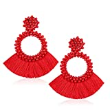 red tassel statement earrings