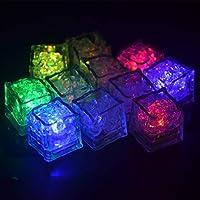Multi-couleur Ice Cubes moules pour partie mariage Club Bar Champagne Glaçons décoratifs de LED. Automatiquement changeant de couleur flash et rougeoyant long temps. Il fait irruption dans la lumière une fois mis dans un liquide quelconque, comme les...
