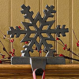 "Made in India Measures 6""W x 5.5""H x 4""D Stocking Hanger is made of iron and features a beautiful cutout of a snowflake, in white finish, with a hook for your stocking Holds up to 1.5 lbs. Holds up to 1.5 lbs."