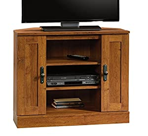 "Accommodates up to a 37"" TV weighing 95 lbs. or less Storage area behind the corner entertainment stand doors has an adjustable shelf and holds 68 CDs or 52 DVDs Two adjustable shelves hold audio/video equipment Abbey Oak finish Engineered wood const..."