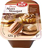 Der Geschmack von fein gemahlenen Nüssen macht unser Nuss-Nougat zu einer beliebten Backzutat.Zaubern Sie köstliche Tortenfüllungen oder kreieren Sie Ihre eignen Pralinen. Auch als süßer Überzug für Gebäck ist unser Nuss-Nougat sehr beliebt. Der Gesc...