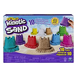 Box of kinetic sand showing sand castles on front
