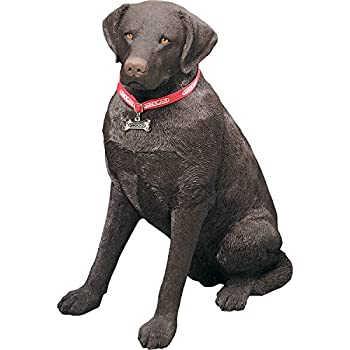chocolate labrador retriever statue sitting