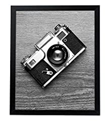Design: Black 16x20 inch poster frame with thick molding, perfect for your cherished memories and favorite Posters; comes with hanging hardware for hassle-free display in both horizontal and vertical formats to hang flat against the wall Material: Wo...