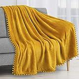 PAVILIA Pom Pom Blanket Throw, Mustard Yellow Gold | Soft Fleece Pompom Fringe Blanket for Couch Bed Sofa | Decorative Cozy Plush Warm Flannel Velvet Tassel Throw Blanket, 50x60