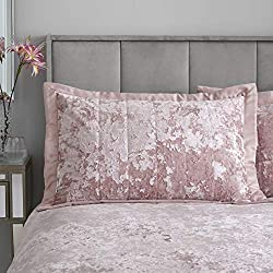 Catherine Lansfield is renowned for style and quality - designed and developed in Great Britain. Blush pink crushed velvet pillowsham pair. Pillowshams Pair 50x75 + 5cm border. Made from a soft to touch 100% Polyester velvet front and a 100% Polyeste...
