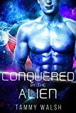 Conquered by the Alien: A Scifi Alien Romance (Fated Mates of the Titan Empire Book 4) (English Edition)