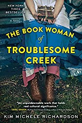 woman holding package book cover the book woman of troublesome creek