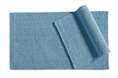 2-pack of 100% cotton bath rugs for use outside of shower, tub, sink, or vanity Plush construction that quickly absorbs and wicks away excess moisture Reversible design with loop pile on one side and cut pile on the reverse Simple, classic design add...