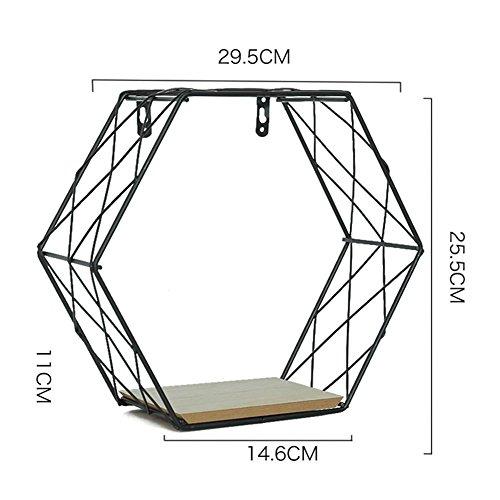 Struttura a ferro galleggiante. Scaffale in metallo esagonale, griglia da appendere alla parete con mensola. Scaffale, figura, decorazione da parete per soggiorno