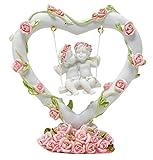 2ángeles en corazón swing con decoración de rosas