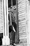 Celebrity Photos Fred Astaire Leaning Against a Wooden Post