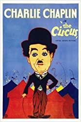 Movie poster for Charlie Chaplin's classic silent movie, The Circus, with a caricature of Chaplin standing in front of circus tents.