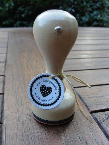Stempel met houten handvat, Ø ca. 3,5 cm.