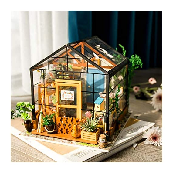 Rolife Dollhouse DIY Miniature Room Kit-Handmade Green House-Home Decoration-Miniature Model to Build-Christmas Birthday… 2 【Exquisite Mini House and Eco-Friendly Materials】Our diy mini doll house is very well made, using a miniature scale of about 1:24. All pieces are in seperate bags and a colourful step by step instruction book is included, which is a joy to read and very clear.The materials in the kit are eco-friendly, have no burrs.The paint is odorless and can also be easily washed out by water 【DIY Model Kits and A Handmade Toy】This wood model kits will make you fall in love with arts and crafts and become fulfilled. Inside the furniture suite are easy to stitching, Even if you are a beginner, follow the steps to do it will not be too hard. You can give yourself a plan, spend two hours a day to assemble, stick to it, not only develop good habits, but also make a surprise toy house 【Be Patience and Feel Amazing】To build it, patience is the ultimate key to success.It can be assembled with family, friends and lovers to experience the pleasure of hands-on.A sense of accomplishment will come when it is finished.You can redecorate it and add in your new creation.After turning on the light, it makes a comfy, cute room to look at once and awhile