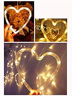 (Hearts and Stars) shapes window hanging LED warm yellow lights battery operated at Eid, Ramadan, Christmas and wedding in...