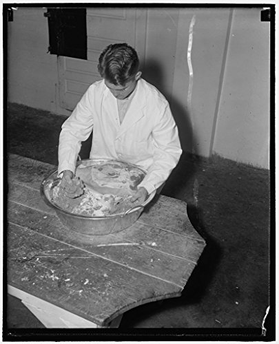 24 x 18 Art Canvas Wrapped Framed Print of Hams. Mr. Carroll Then Rubs The Cured Ham in A Mixture of Salt, Brown Sugar, and Saltpeter Before It is Smoked 1940 Harris & Ewing 86a