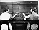 Rear view of two female telephone operators operating a telephone switchboard Print Type Paper Size: 24.00 x 36.00 inches Licensor: Superstock