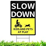 """Promote Road Safety: The """"Slow Down Kids and Pets at Play"""" sign has a bright and alarming black and yellow design. It helps remind the driver to see it from a safe distance and immediately slow down and reduce the danger. Easy to install: This slow d..."""