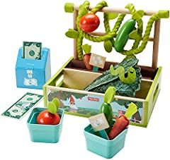 "​Role play garden and market stand for kids ages 3 year and up ""​Plant"" And ""grow"" Veggies, then sell them at the farmer's market! ​Planter box with fabric ""dirt,"" soft vines, wood trellis, play vegetables, and 2 baskets ​Wooden crate, 2-sided signs,..."