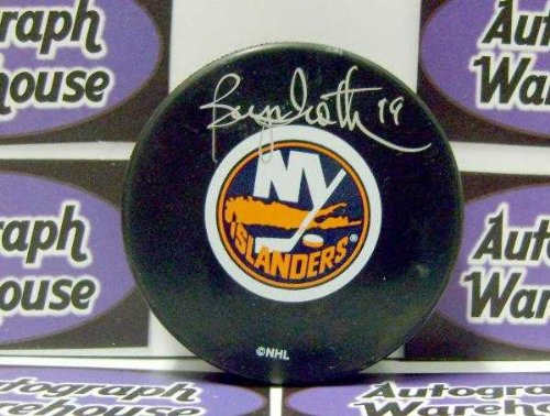 Bryan Trottier autographed Hockey Puck with free display cube (New York Islanders Stanley Cup Hall of Fame)