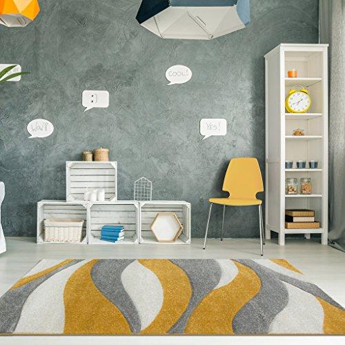Alfombra amarilla moztaza para sala de estar con diseño en curvas